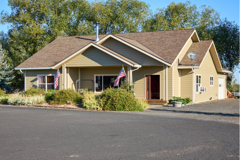 Gorgeous Home with Creek Frontage and a Shop!