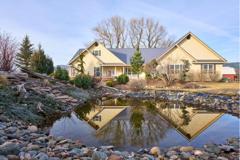 Modern Farmhouse on 27+ Acres with a Pond and Wallowa River Frontage